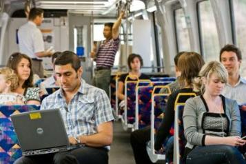 photo of commuters on a train