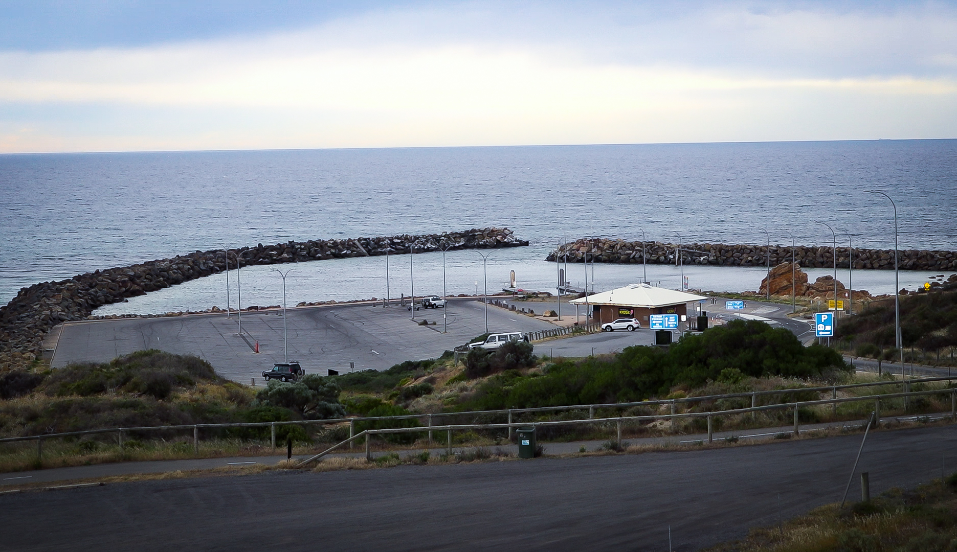 A view of the O'Sullivan Beach car park, kiosk and boat ramp, taken from a hill.