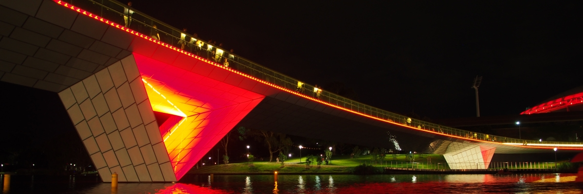 Riverbank bridge at night time